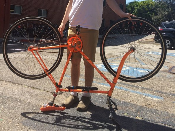 This step will be easier if you flip your bicycle upside down, and balance it on the seat and handlebars.