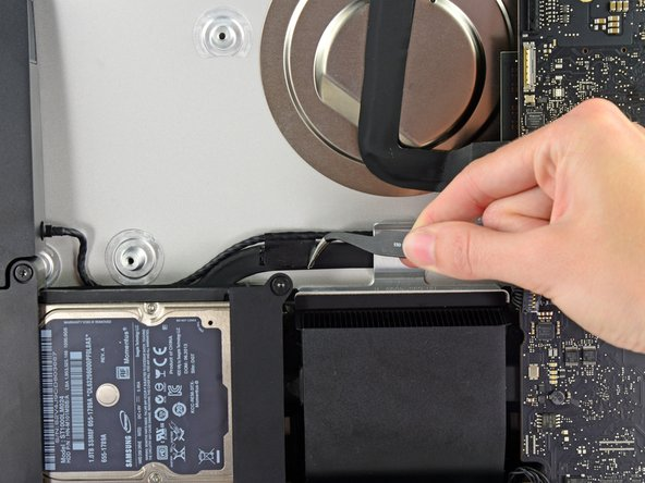 If necessary, use a pair of tweezers to peel the tape securing the left speaker cable to the SATA data/power cable.