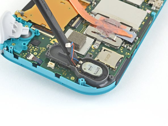 Insert a spudger into the gap at the top of the speaker.