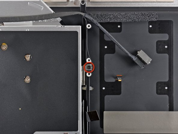 Remove the single 3.5 mm Phillips screw securing the inner side of the optical drive to the upper case.
