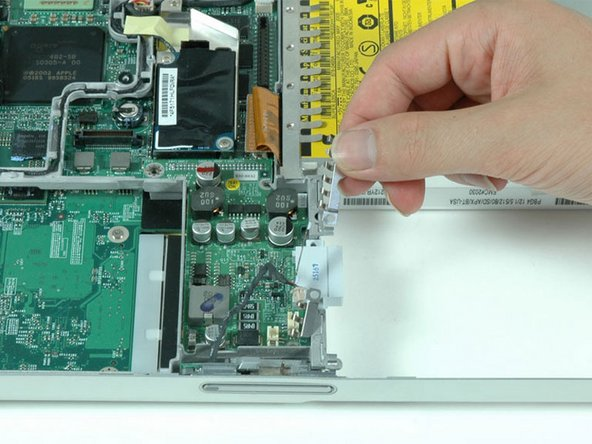 Remove the silver EMI fingers located near the battery contacts.