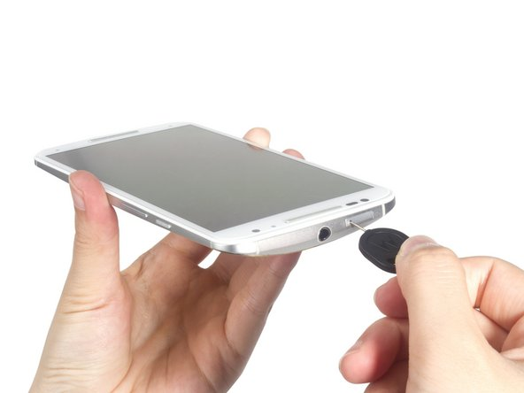 Remove SIM card tray. Remember to power off the phone at first.