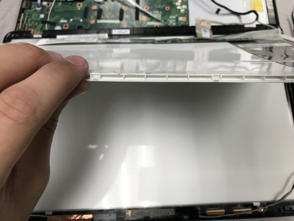 Pull the white part out and pull out the rest of the screen.