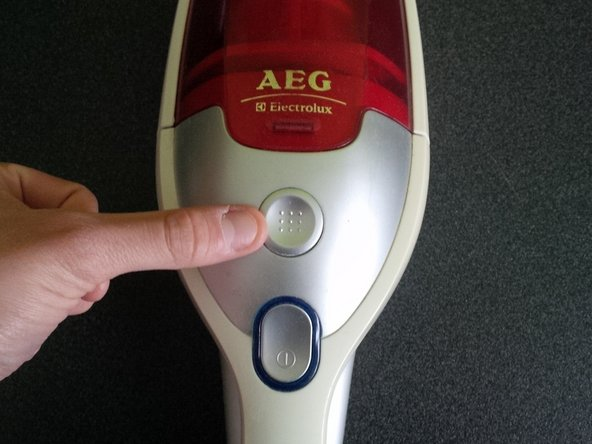 Open the lid by pressing the grey button and lifting it away.