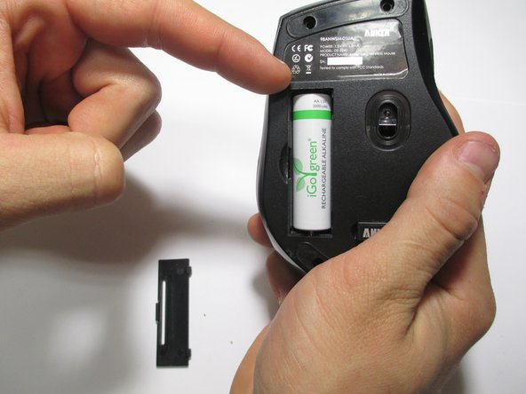 Remove the battery with a finger nail or a nonmetal tool.