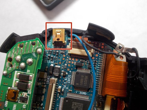 The A/V port is glued to the motherboard. Heat should be applied carefully with a heat gun to loosen the adhesive.