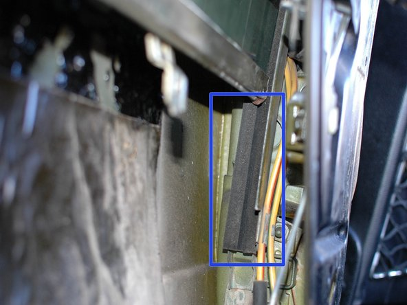 If you window is hard to move up and down by hand you can consider greasing the felt slides within the side window rails with a synthetic grease such as silicone. The bottom end is shown; it goes all the way up in to the door.