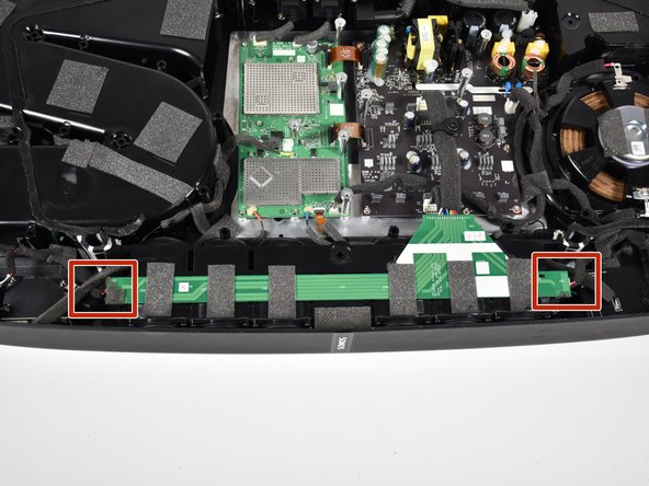 Remove the side speakers from the green printed circuit board (PCB) running along the top of the main speaker array by pinching and pulling  out the connector.
