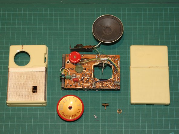 Finally, here are all the pieces of the fully disassembled TR-63 transistor radio, with both front and back views of the circuit board.