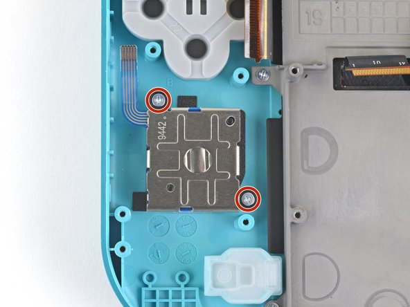 Use a Phillips screwdriver to remove the two 3.5mm screws securing the joystick.