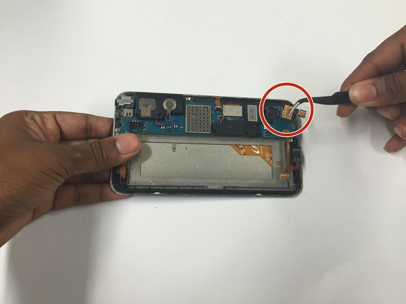 Remove the rear and front facing cameras by lifting the tab that they are attached to with the tweezers, they should come up quickly, and together.