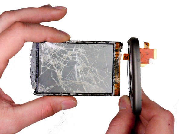 Carefully feed the ribbon cable through the slot in the plastic frame.