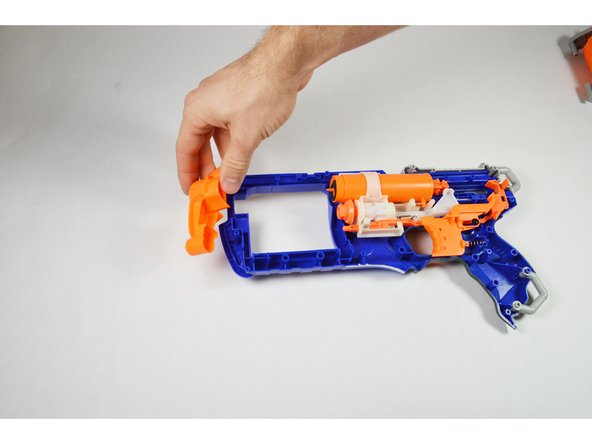 Once the barrel is removed, continue by removing the front shaft. This component is also independent of the blaster and does not require tools.