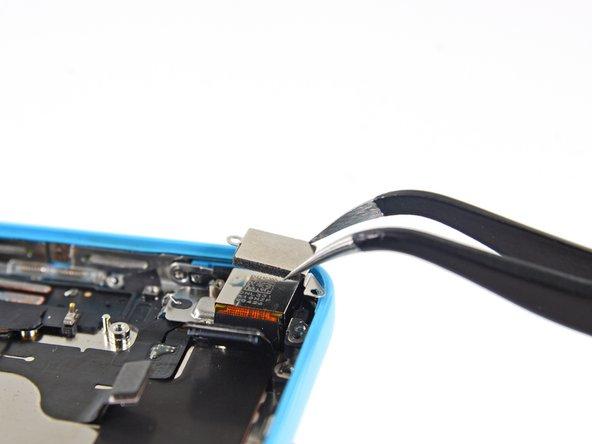 Remove the rear facing camera cover.