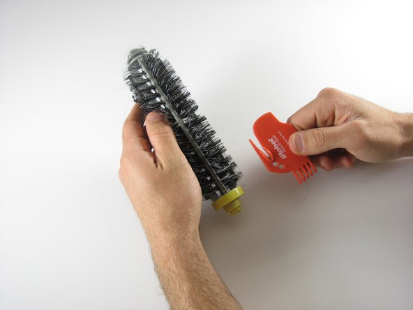 Use the included hair cutter to cut through hair that has gotten caught in the brush