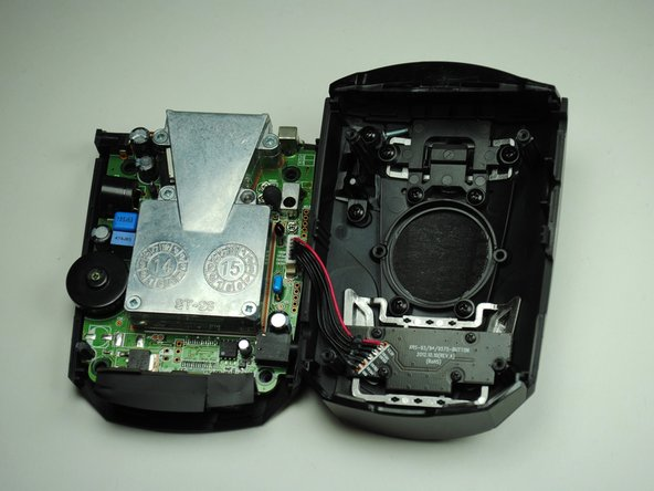 Lift up the motherboard and lay it flat next to the device.