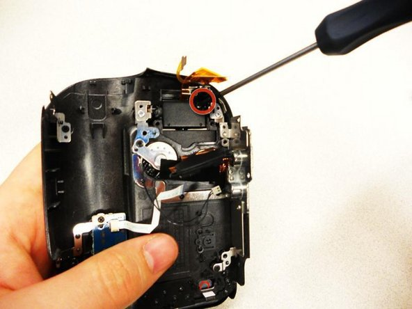 Remove (1) 2.9mm screw from the base of the LCD screen.
