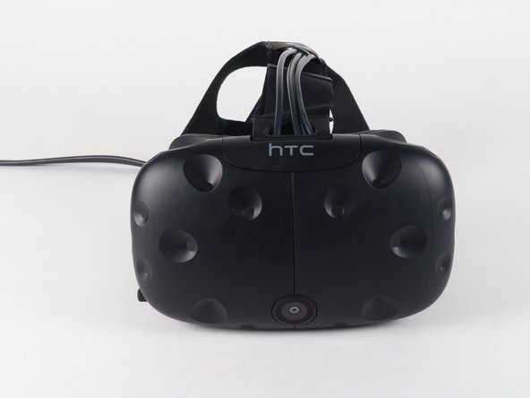 Slide the HTC panel covering the cables forward, away from the Vive.