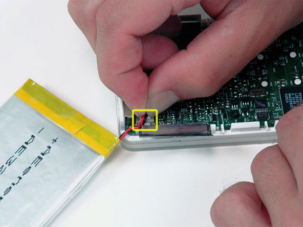 Carefully disconnect the white battery connector from the logic board. Be sure to pull only on the connector itself and not on the cables.