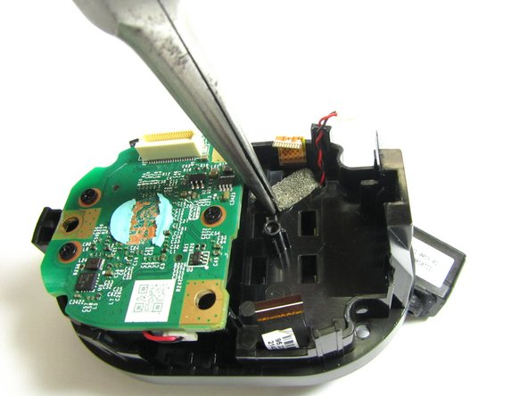 With the Large EMI / Heatsink Shield removed, we can now remove the Flex PCB that contains the Microphones, Light Detector, Multi-Color LED and PIR Sensor