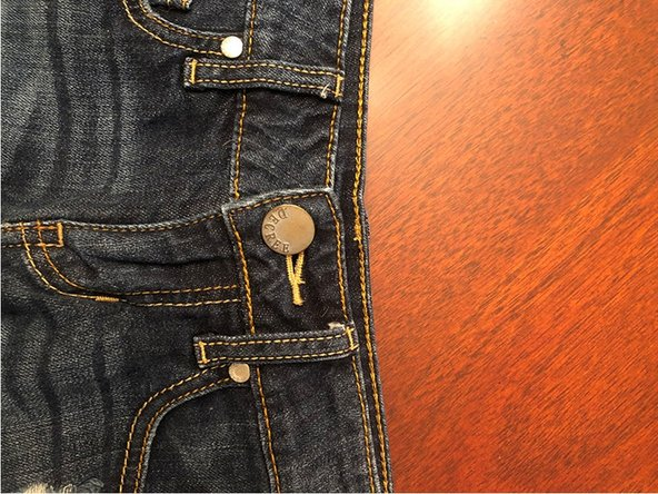 Using a seam ripper, rip the seams off your pair of jeans.