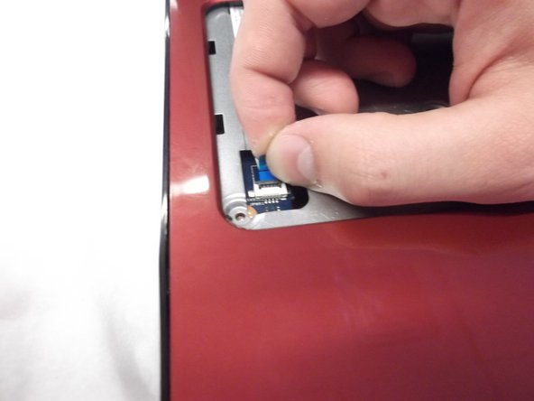 Now peel back the glued longer ribbon cable gently.