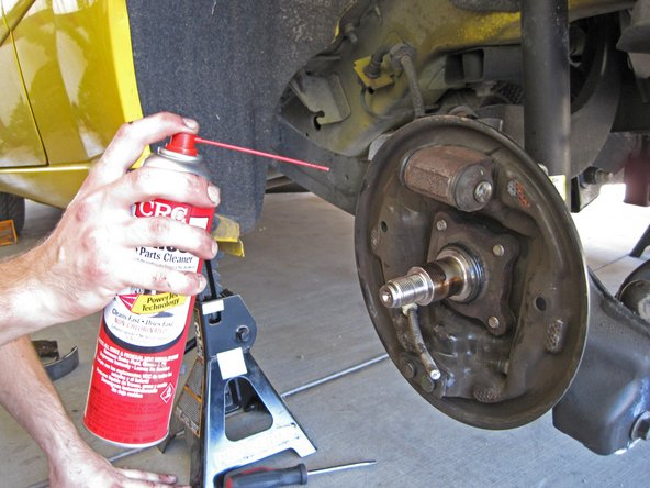 Use an aerosol brake cleaner to clean all of the dirt and brake dust from the hub assembly.