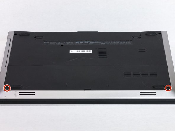 Remove the two 5.5mm screws that secure the base cover to the computer's base.
