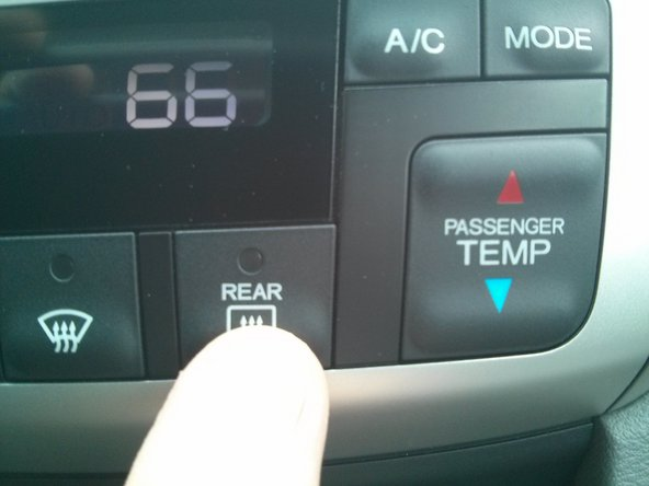 Cycle through the displayed values with the REAR DEFROSTER button. The code for display displays in the left (Driver's temp) segment, alternating the code number and the value.
