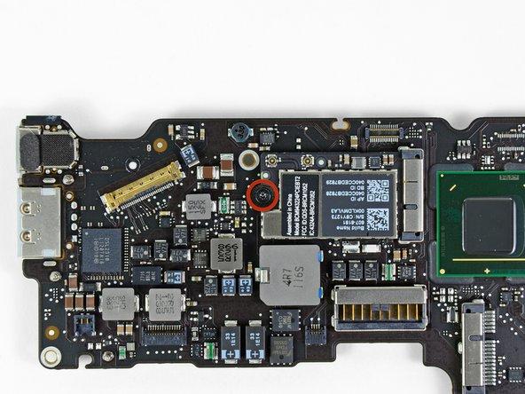 Remove the single 2.9 mm T5 Torx screw securing the AirPort/Bluetooth card to the logic board.