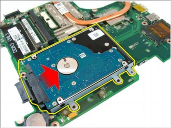 Slide the hard-drive module to release it from the system board