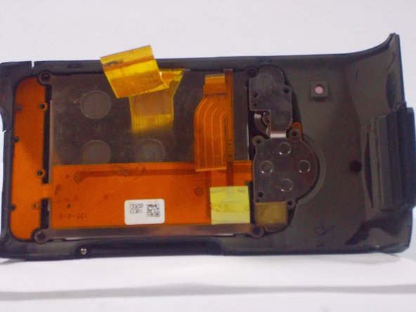 Use a plastic opening tool to separate the LCD and metal plates from the casing.