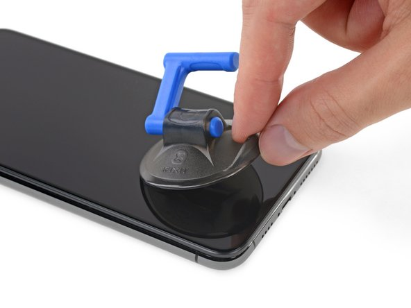 Pull on the small nub on the suction cup to remove it from the front panel.