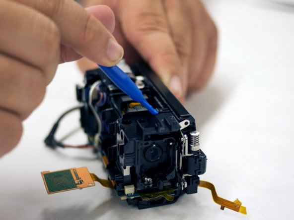 Use your blue plastic opening tool to disconnect the lens assembly from the hull.
