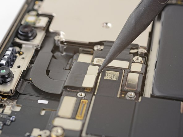 Use a spudger or a fingernail to disconnect the Face ID dot projector cable from its socket on the logic board.