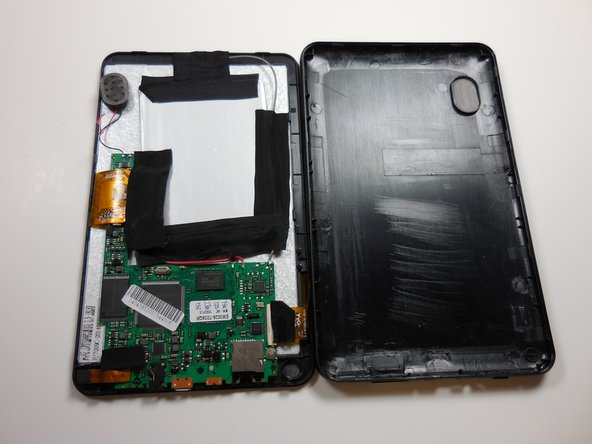 Once the speaker is disconnected, the cover removal is complete.