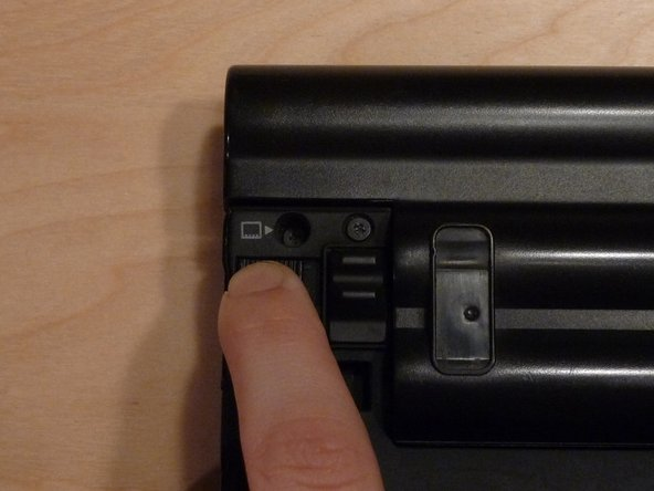Turn the laptop upside-down, with the battery oriented away.