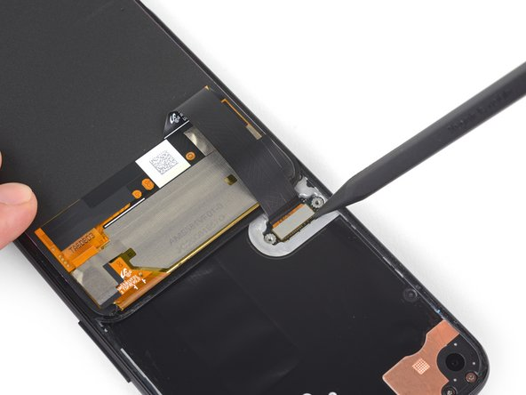 Use the tip of a spudger to pry up and disconnect the screen flex cable.