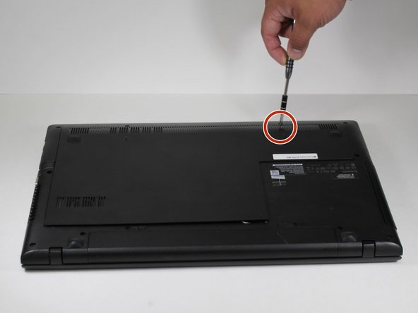 Locate a Phillips head screwdriver. Use the screwdriver to remove the 2 screws found on the backside of the Lenovo G70-80. Once both of these screws are removed you will be able to remove the back of the laptop.