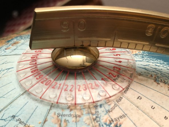 With a plastic meridian like this one, you need to raise the meridian slightly from the North Pole. Use the plastic ring on the north pole to gently press the globe down and pull up the meridian so you lift the little pin,which holdes the globe.