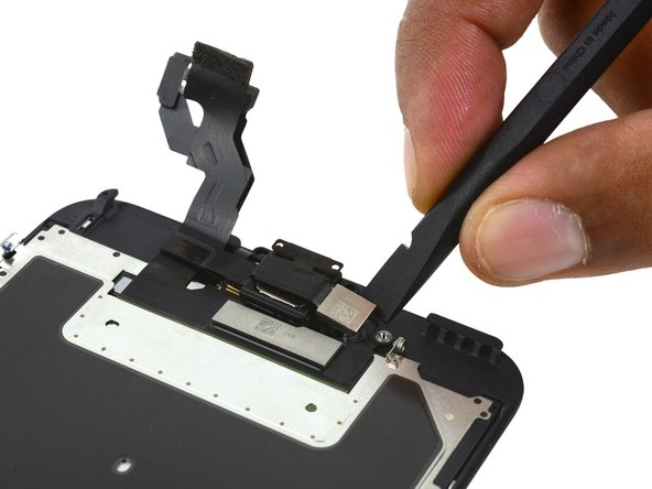 Use the flat end of a spudger to lift the FaceTime camera out of its housing.