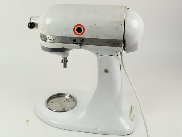 Unscrew the brush cap on each side of the mixer using a flat head screwdriver.