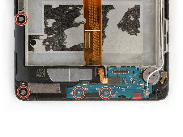 Remove the four Phillips #00 screws holding the daughterboard and loudspeaker to the phone.