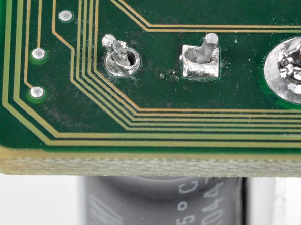 Insert the contacts into and through the holes made in the solder pads.