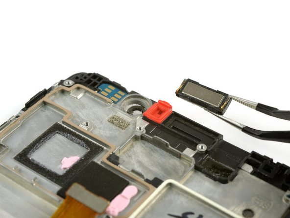 Use tweezers to remove the earpiece speaker.