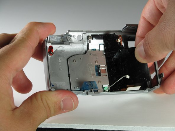 Peel the black tape off the back of the LCD.