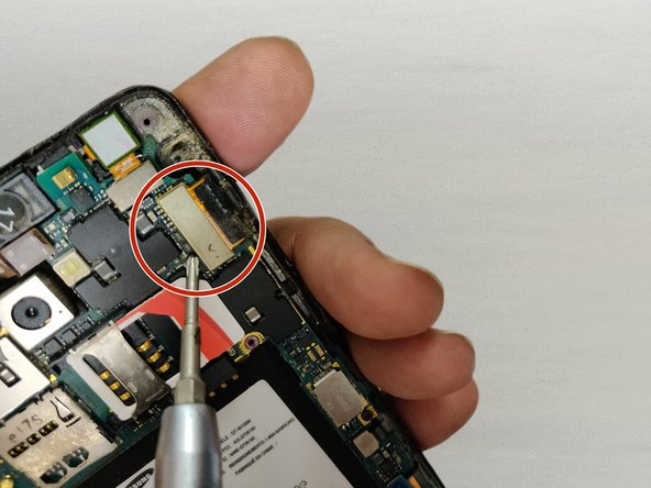 Use a screwdriver or another pointed tool to disconnect the screen connector.