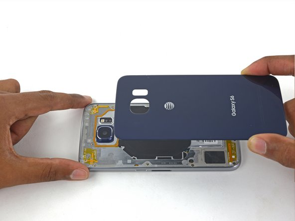Align the top of the rear glass with the top of the phone.