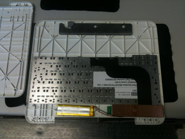 Once the screws are removed, lift off the bottom panel to access the keyboard and battery.