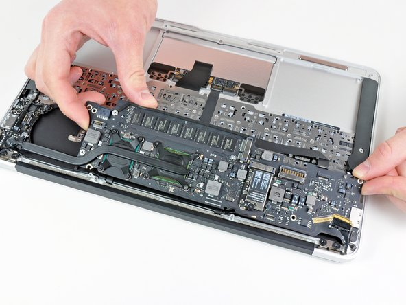Gently lift the logic board assembly out of the upper case, minding the fragile heat sink and any cables that may get caught.